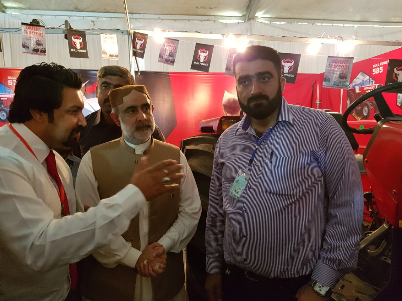 Federal Minister of Agriculture, Sahibzada Mehboob Sultan being briefed about Orient Tractors and Bull Power Brand